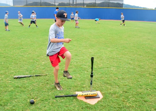 Rocco Aloisi, 8, rounds the bases to home at a baseball camp held at Karns High School Thursday, July 11.