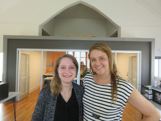 Tiffany Gentry, left, and Michelle Mokry of Smee + Busby Architects stand inside former church on July 1.