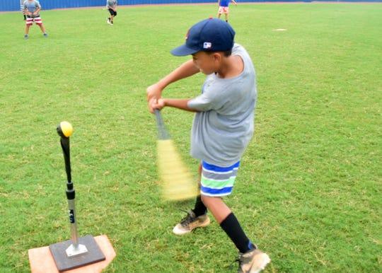 Hustin Rono, 8, practices his batting mechanics at a baseball camp held at Karns High School. 7/11/19