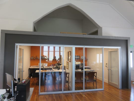 Firm principals' office built in lowered former altar area of church.