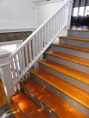Restored stairway by side entrance door is considered a real eye-catcher.