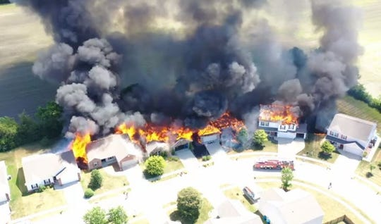 Aerial view of Friday's five-house fire in Limberg Village.
