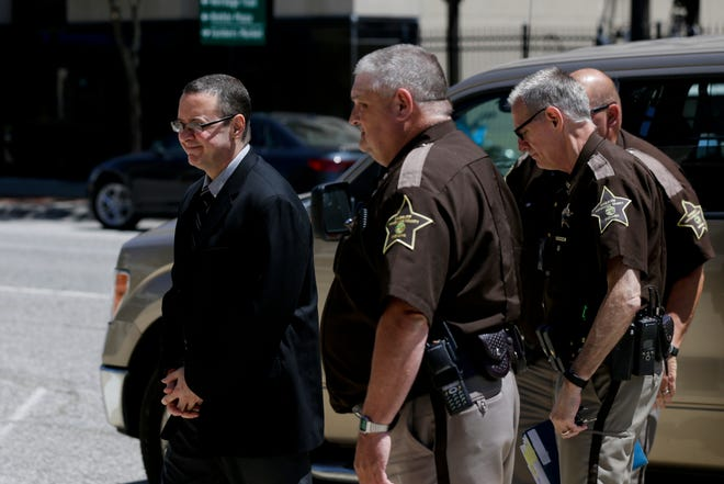 Patrick Elliott is escorted into the Tippecanoe County Courthouse by sheriff's deputies for jury selection, Friday, July 12, 2019 in Lafayette. Elliott, 50, is accused of killing his wife on Aug. 8, 2017.