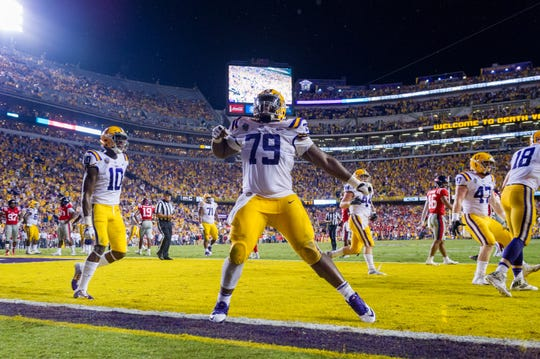 Sep 29, 2018; Baton Rouge, LA, USA; LSU Tigers center Lloyd Cushenberry III (79) reacts during a game against the Mississippi Rebels at Tiger Stadium. Mandatory Credit: Scott Clause/The Advertiser via USA TODAY NETWORK
