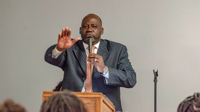 Pastor Charles Banks leads the funeral service for Mar'Kavin Cormier as family and friends gather at Kinchen Funeral Home Friday, July 12, 2019, to pay their respects to the 2-year-old.