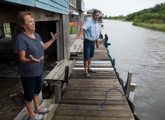 Linda, left, and Lee Morvant talk about the water level at their fish camp in Isle de Jean Charles, La., on Friday, July 12, 2019. Isle de Jean Charles is slowly shrinking due to rising sea levels.