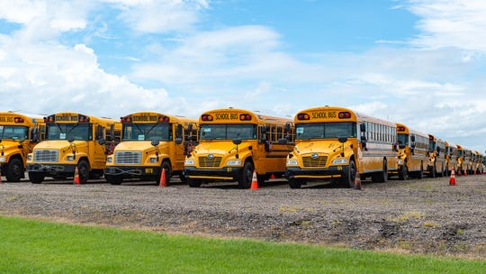School buses staged at Lafayette Regional Airport in advance of Tropical Storm Barry.  Friday, July 12, 2019.