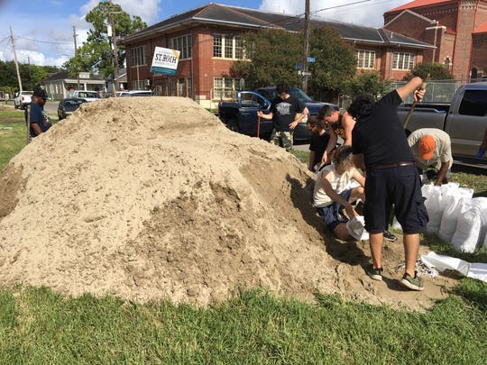 The St. Roch neighborhood organized a sandbag pickup location on Thursday July 11, 2019 to help local residents prepare their homes for Tropical Storm Barry.