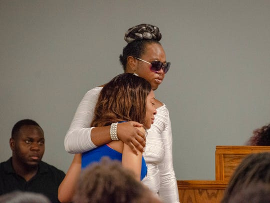 Family and friends gather at Kinchen Funeral Home Friday, July 12, 2019, to pay their respects to 2-year-old Mar'Kavin Cormier.