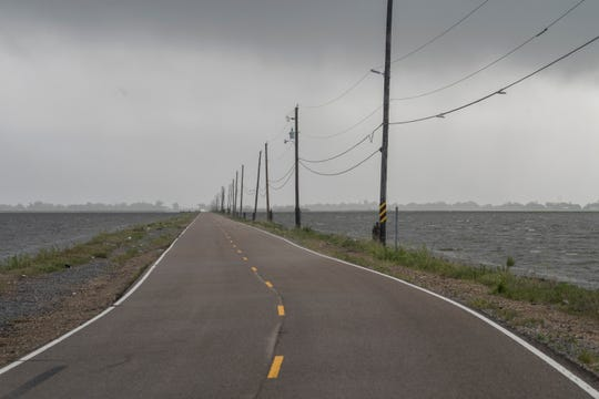 Island Road looking out of Isle de Jean Charles, La., on Friday, July 12, 2019. There is only one way in and out of Isle de Jean Charles which is slowly shrinking due to rising sea levels.