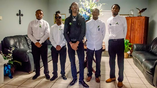 Deiondre Solomon (center) and other pallbearers wait for 2-year-old Mar'Kavin Cormier's funeral to begin on July 12, 2019 at Kinchen Funeral Home.