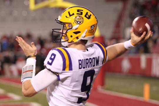 Nov 10, 2018; Fayetteville, AR, USA; LSU Tigers quarterback Joe Burrow (9) warms up prior to the game against the Arkansas Razorbacks at Donald W. Reynolds Razorback Stadium. Mandatory Credit: Nelson Chenault-USA TODAY Sports