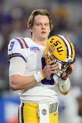 Jan 1, 2019; Glendale, AZ, USA; LSU Tigers quarterback Joe Burrow (9) looks on prior to the 2019 Fiesta Bowl against the UCF Knights at State Farm Stadium. Mandatory Credit: Joe Camporeale-USA TODAY Sports