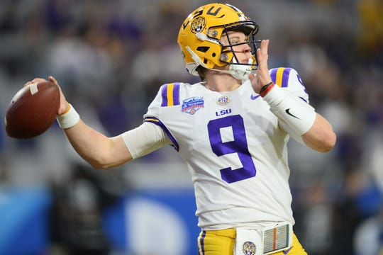 Jan 1, 2019; Glendale, AZ, USA; LSU Tigers quarterback Joe Burrow (9) warms up prior to the 2019 Fiesta Bowl against the UCF Knights at State Farm Stadium. Mandatory Credit: Joe Camporeale-USA TODAY Sports