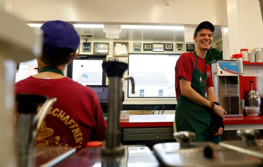 Graham Schaffner, right, laughs as he and Pam Whittington talk during lull in the rush of customers Thursday, July 11, 2019, at Schaffner's Drive In in Baltimore.