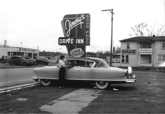 The front parking lot of Jimmy's Drive-Inn, 531 Lincoln Ave., is shown in this photo and feature's Jimmy's distinctive sign. The restaurant stood behind the car on the north side of Lincoln Ave. The photo was taken looking west.