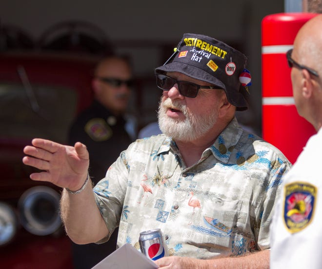 Former Putnam Twp. Fire Chief Greg Amburgey talks to fellow fire officers Friday, July 12, 2019 at his retirement party held at the Putnam Twp. fire station.