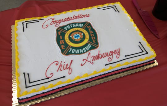 A cake is specially decorated to celebrate the retirement of Putnam Twp. Fire Chief Greg Amburgey Friday, July 12, 2019.