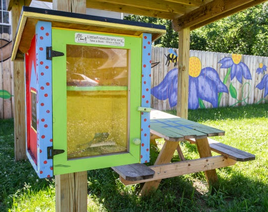A free little library at a revitalized  community green space in the Baker-Donora neighborhood as part of the Greater Lansing Association of REALTORS annual Adopt a Park program in 2018.