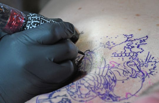 The beginnings of a tattoo at the 2019 INKcarceration Festival.