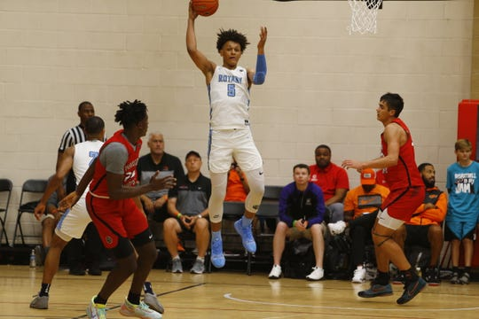 Paolo Banchero, rated the No. 5 recruit in the class of 2021, pulls down a rebound for Seattle Rotary Thursday night at Nike's Peach Jam in North Augusta, South Carolina.