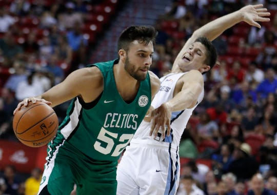 The Celtics' Max Strus drives around the Grizzlies' Grayson Allen during a summer league game in July.