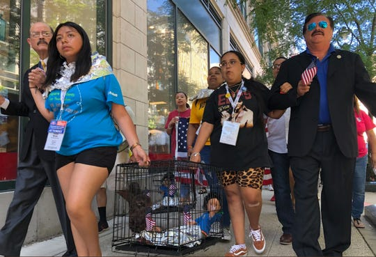Domingo Garcia, president of the League of United Latin American Citizens, marches with student activists to the Milwaukee office of U.S. Ron Johnson on Friday, July 12, 2019. The students carried an animal cage holding a baby doll wrapped in tin foil, mimicking conditions for children reported at the U.S.-Mexico border.
