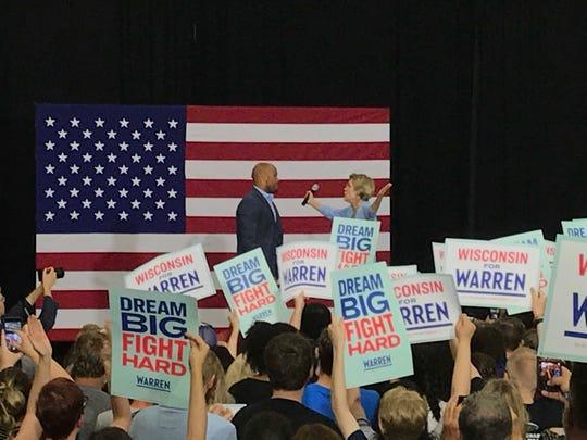 Sen. Elizabeth Warren of Massachusetts goes for a hug with Wisconsin Lt. Gov. Mandela Barnes, who introduced Warren to the stage.