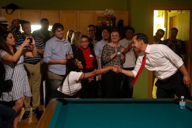 Julián Castro shakes hands with Milwaukee County Supervisor Marcelia Nicholson as he enters the Wisconsin Working Families Party office following the Univision-LULAC Presidential Town Hall on Thursday, July 11, 2019.