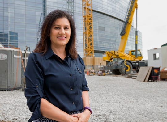 Patricia Najera is leaving the Plan Commission after 20 years on that panel, including several years as chair. She stands in front of Northwestern Mutual Life's office tower that's under construction in this 2016 photo.