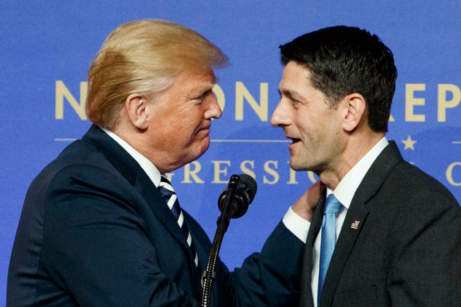 In this March 20, 2018, file photo, Speaker of the House Paul Ryan, R-Wis., greets President Donald Trump to speak to the National Republican Congressional Committee March Dinner at the National Building Museum in Washington.