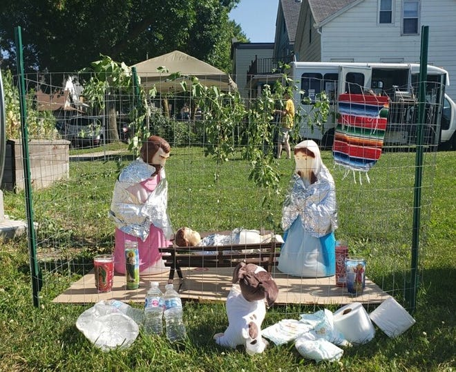 A Nativity scene depicts Jesus, Mary and Joseph as migrants held in detention centers. The scene was set up Friday at a taco truck rally in Milwaukee.