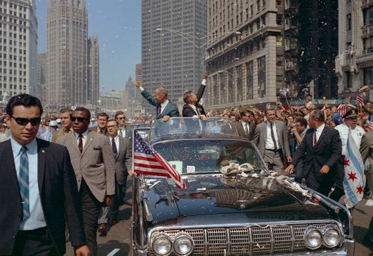 35mm color film negative of a parade for the Apollo 11 crew in Chicago. Neil Armstrong, Edwin (Buzz) Aldrin and Michael Collins. An estimated two million people were at the parade which traveled through the Loop area. This photo shows Aldrin and Armstrong waving to the crowd.  Date is 8/13/1969. These are outtakes taken by George (Sam) Koshollek. moon landing, space travel, NASA