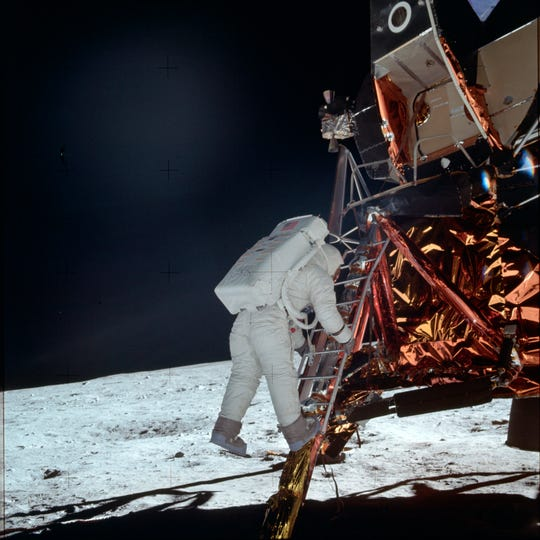 Preparations took nearly four hours before Neil Armstrong emerged from the Lunar Module. He was followed 20 minutes later by Buzz Aldrin. And for the first time in human existence, a non-earth destination was reached. This July 20, 1969, photo made available by NASA shows Aldrin descending a ladder from the Lunar Module during the Apollo 11 mission.