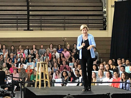 Sen. Elizabeth Warren speaks to the crowd Thursday night at South Division High School in Milwaukee.