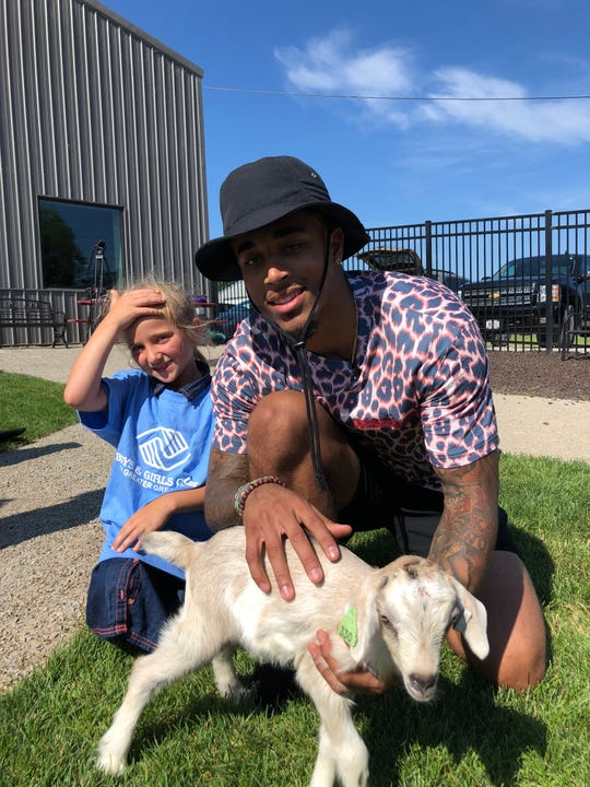 Green Bay Packer Jaire Alexander talked to a lot of the children who came out to try goat yoga.