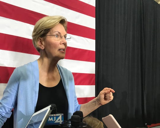 Sen. Elizabeth Warren speaks to reporters after a campaign event Thursday at South Division High School in Milwaukee. She also released on Thursday her plan to address immigration issues.