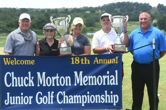 John Daly Jr. of Clearwater, Fla., won the boys' championship, while Josie Roberson of Maumelle won the girls' title of the Chuck Morton Junior Golf Tournament on Friday at Big Creek Golf & Country Club. Pictured with the overall trophies are (from left) Big Creek head professional Todd Dunnaway, tourney director Beverly Morton, Roberson, Daly Jr., and tourney director Mark Morton.
