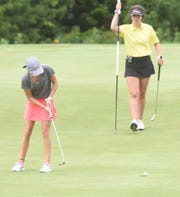Mountain Home's Sydney Czanstkowski watches her putt roll around the cup on the 16th hole Friday at Big Creek.