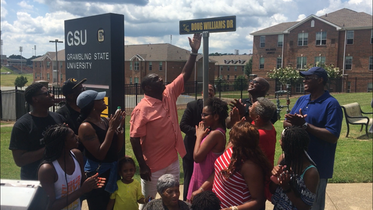 Doug Williams, with his family, was honored Friday afternoon at Grambling State University with a street named after him.