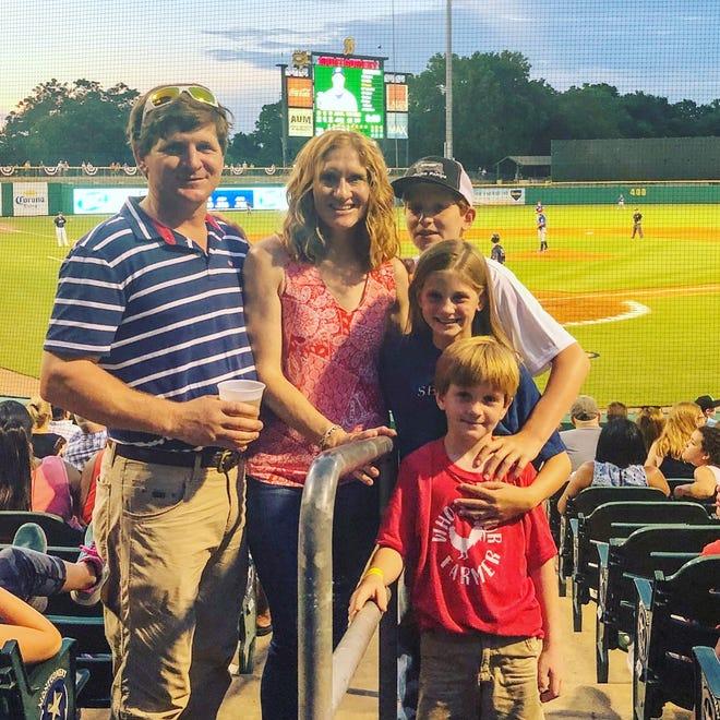 Writer, Bradley, and her family soaking up in the fun at Riverwalk Stadium.