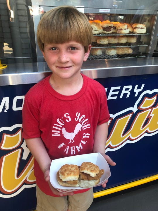 Little Shep happy to eat Fried Chicken Biscuits.