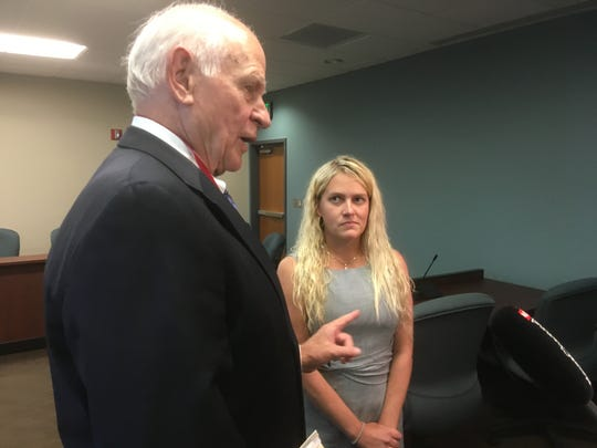 "Kelsey Ketron, right, listens as Aubrey Harwell, one of her attorneys, speaks in her defense. Ketron faces charges that she engaged in ""fraudulent"" practices as an unlicensed insurance agent."