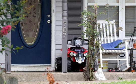 A child's shoes and toys sit on the front porch of a Smyrna home were a 3-year-old died after being left in a vehicle.
