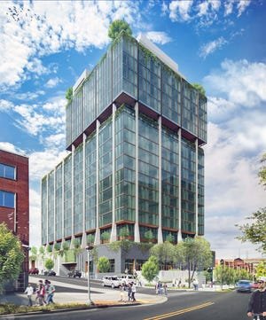 An architectural rendering of the 16-story Marriott Edition hotel planned for a vacant lot at 1100 Grundy