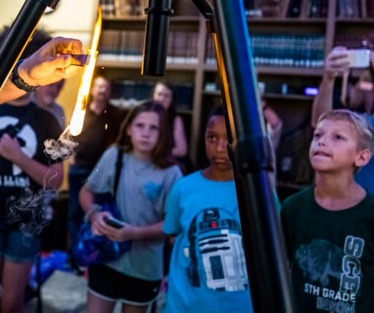 Kids attending a camp at Dyer Observatory observe as astronomer Dr. Billy Teets conducts an experiment Friday, July 12, 2019.