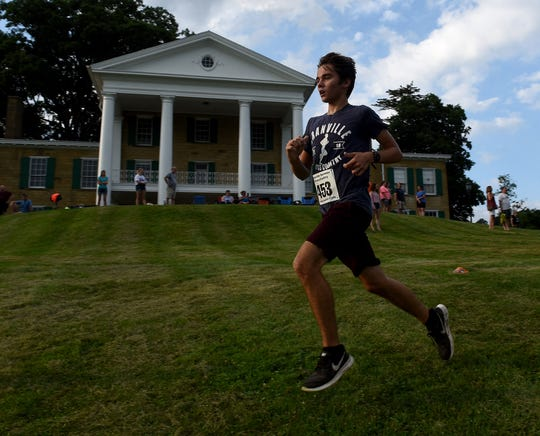 Granville senior Rudy Bradley crosses in front of the mansion during the first Bryn Du Summer Cross Country Series race held on Thursday, July 11, 2019.
