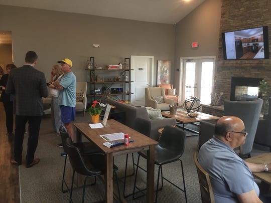 Chamber and city officials meet with developers in the community center/club house area of the new apartment complex on July 12.