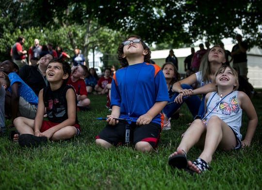 Zavry Careuns, Raoul Jarvis and Taylor Hupp watch excitedly as water rockets were launched outside Par Excellence Academy. Par Excellence partnered with Owens Corning, Boeing and OSU-Newark to commemorate the anniversary of the Apollo 11 launch.