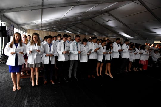The Class of 2019 recites the Physician's Pledge during a White Coat Ceremony at Hackensack Meridian School of Medicine at Seton Hall University in Nutley on Thursday, July 11, 2019.